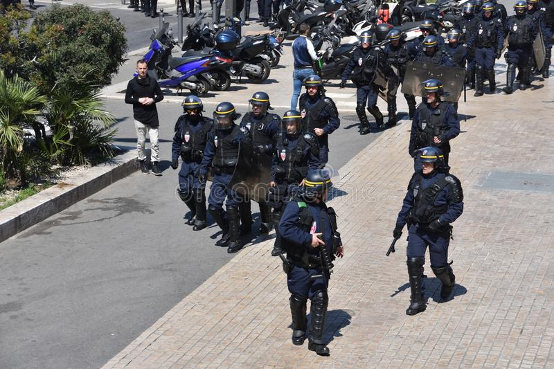 Helmeted police officers. Marseille, France - May 01, 2019 : Helmeted police officers photographed from behind during a protest stock photo