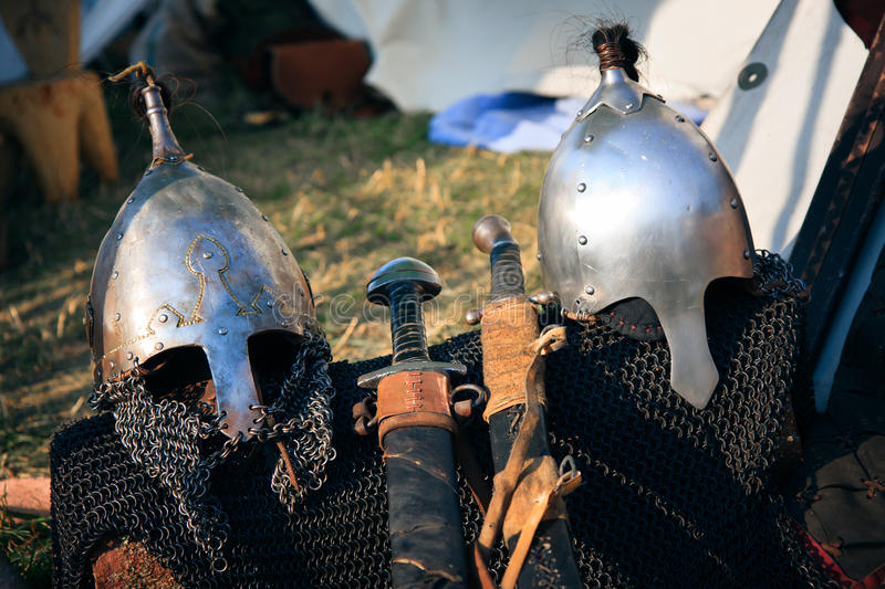 Helmets and swords royalty free stock images