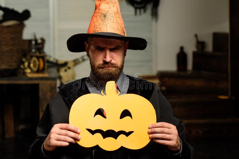 Helowin scenery for the holiday. Man holding a carved pumpkin. Party on October 31. Scary background. Happy halloween. Horror faces royalty free stock photo