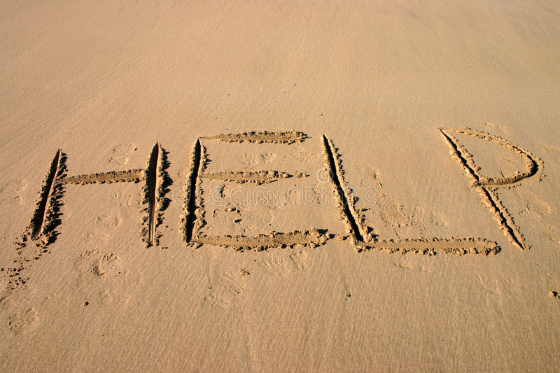 HELP. Written in the sand stock photos