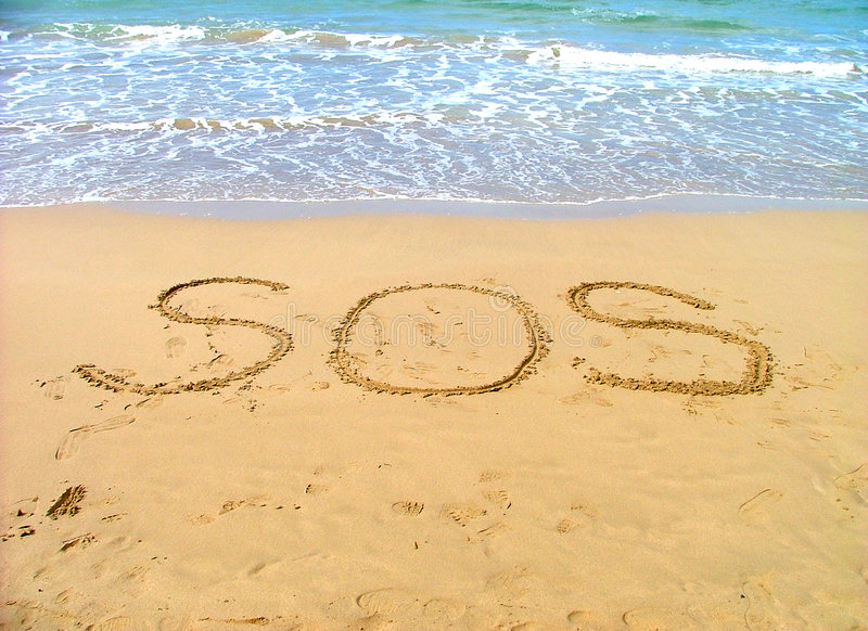 Help. Sos sign for help written in sand