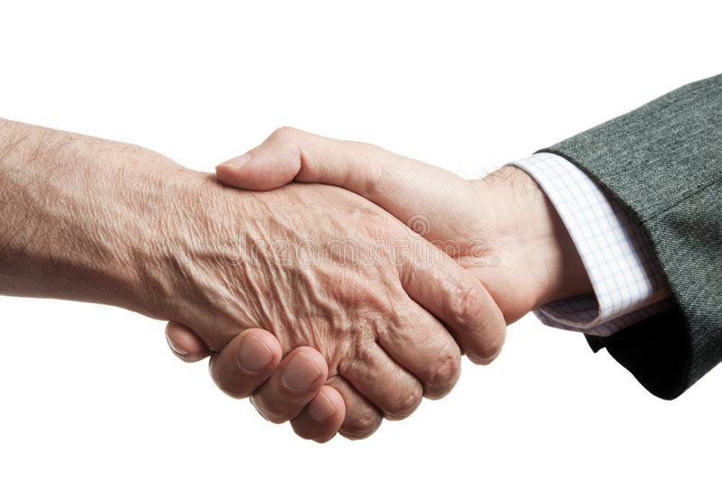 Help. Handshake of businessman and poor man, isolated on white background, focus point on center stock photos