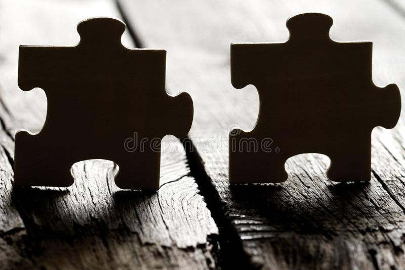 Help in business and teamwork concept with puzzle on the edge. Abstract royalty free stock photography