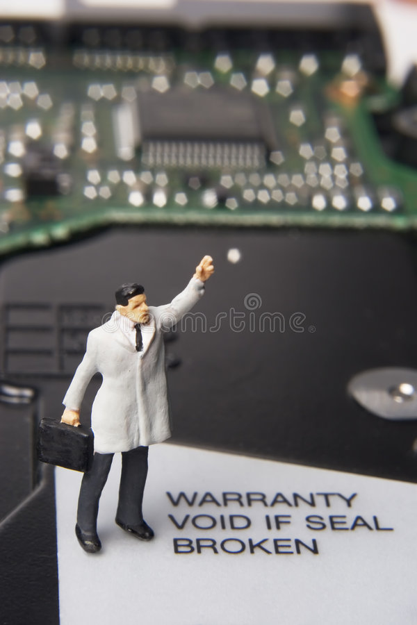 Help with business technology. Business figurine and computer component royalty free stock photography