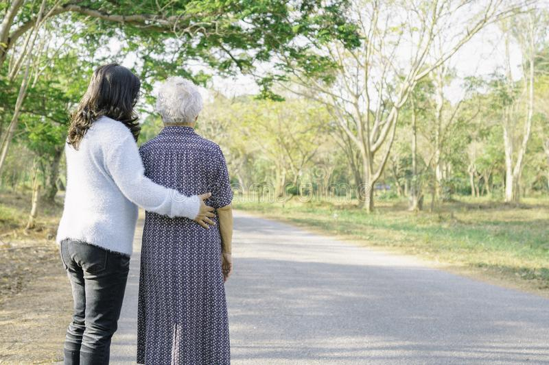 Help and care Asian senior or elderly old lady woman with strong health while walking at park stock photography