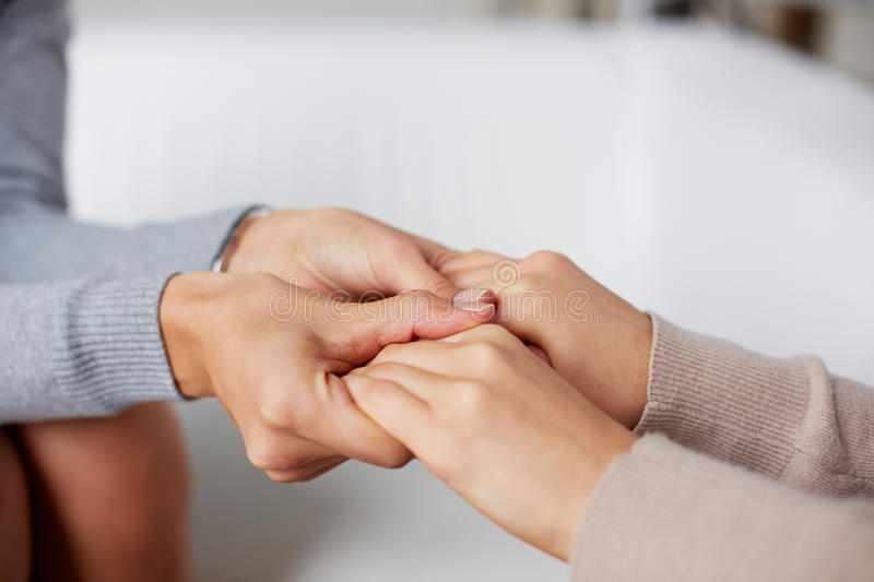 Help. Close-up of psychiatrist hands holding those of her patient stock photos