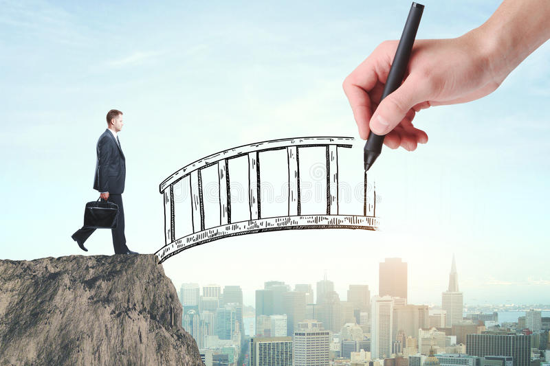 Help concept. Abstract image of businessman with briefcase crossing abstract bridge drawn by hand on city background. Help concept stock photography