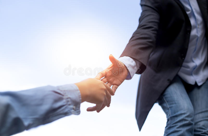 Help concept hand reaching out help someone with blue sky stock photography