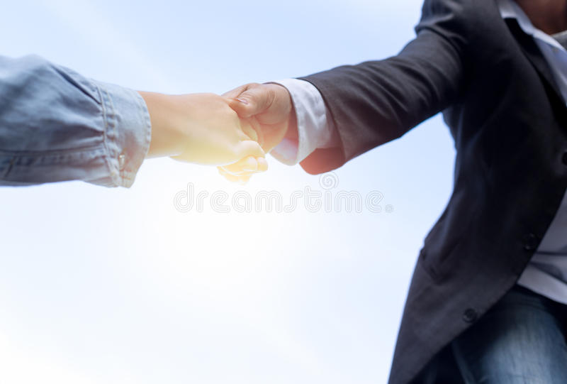 Help concept hand reaching out to help someone with sunlight stock images