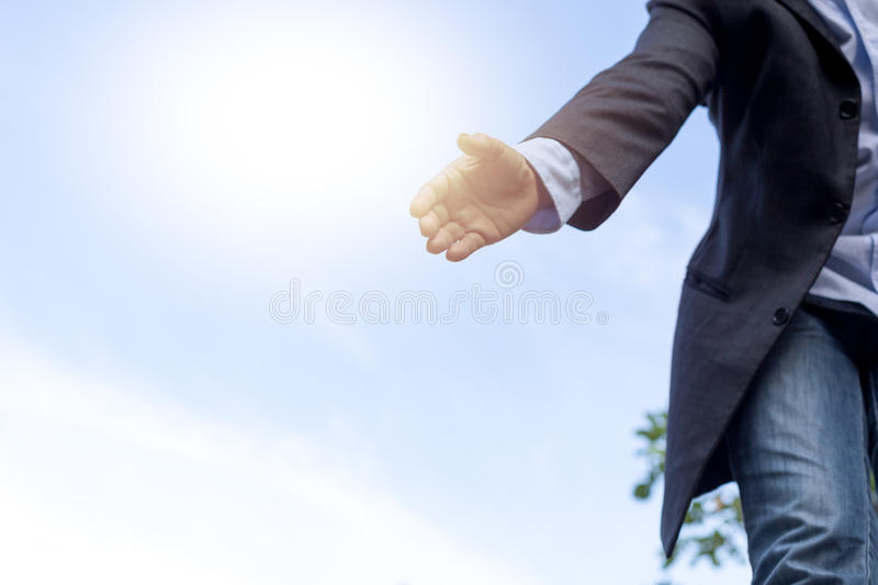 Help concept hand reaching out to help someone with sunlight. Help concept hand reaching out to helping someone with sunlight in background royalty free stock photography