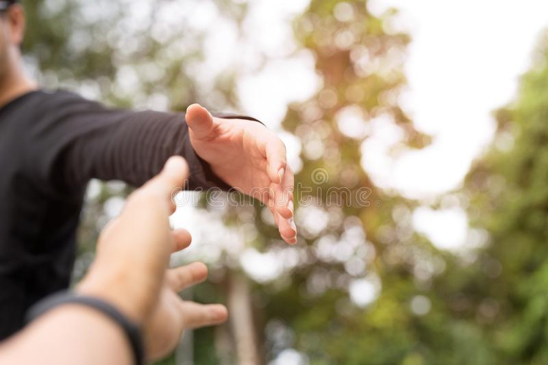 Help Concept Hands reaching out to help each other stock image