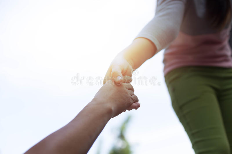 Help Concept Young girl Hands reaching out to help old royalty free stock photos