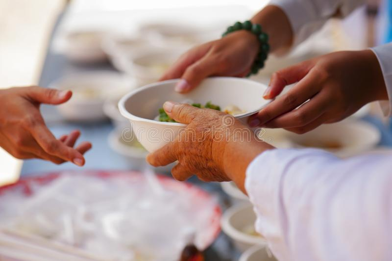 Help with feeding homeless people to alleviate hunger. poverty concept stock photo