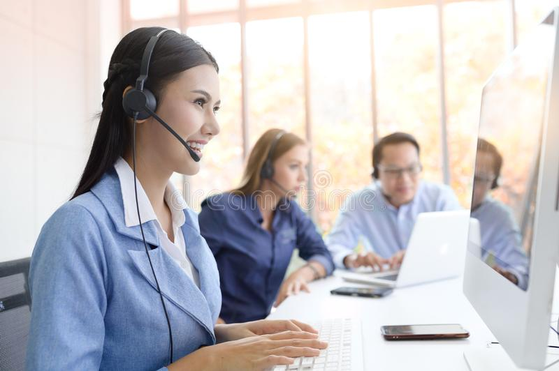 Help line answering and telemarketing. Call Center Service. Photo of customer support or sales agent.  Help line answering and telemarketing. Female caller or stock photo
