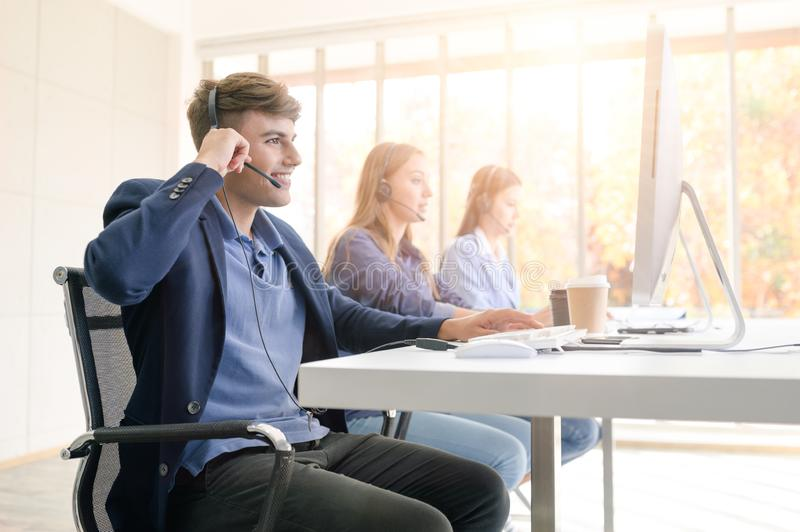 Help line answering and telemarketing. Call Center Service. Photo of customer support or sales agent.  Help line answering and telemarketing. Male caller or royalty free stock photography