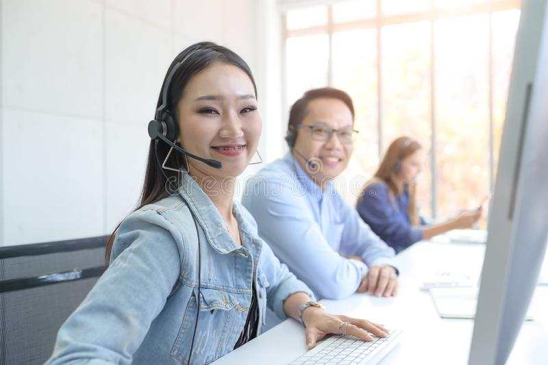 Help line answering and telemarketing. Female caller or receptionist phone operator. Call Center Service. Photo of customer support or sales agent.  Help line royalty free stock photo