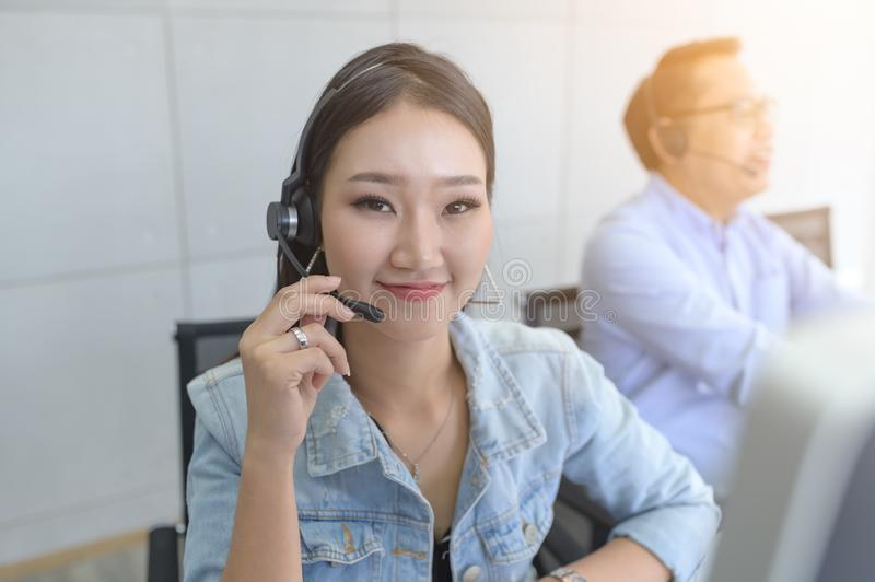 Help line answering and telemarketing. Female caller or receptionist phone operator. Call Center Service. Photo of customer support or sales agent.  Help line stock image