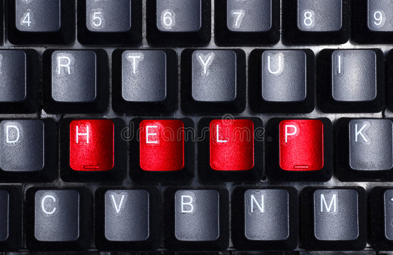Help me. The word help visible on the keyboard