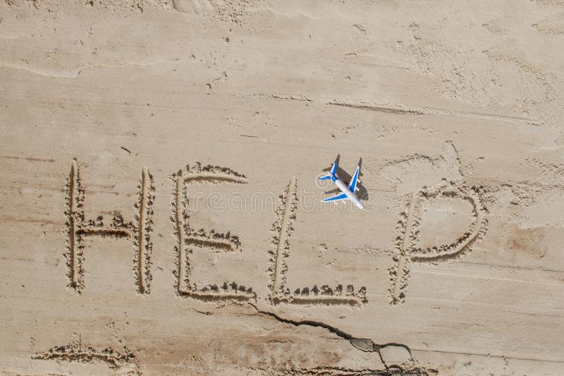 Help me the inscription and plane on the sand. Please help me. On a tropical beach.  stock photo