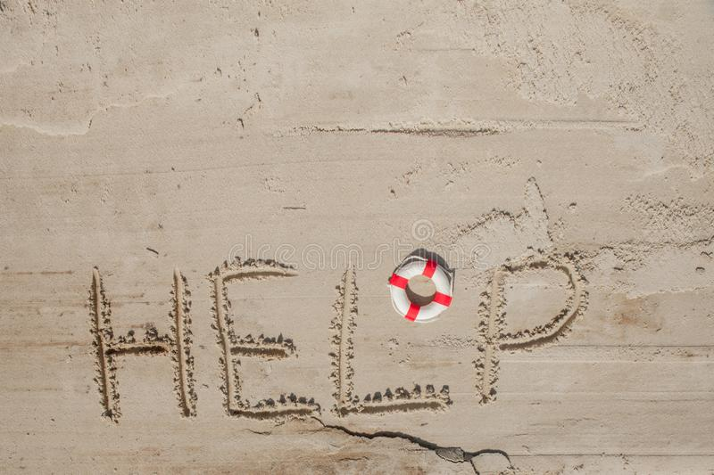 Help me the inscription on the sand. Please help me. On a tropical beach royalty free stock photo