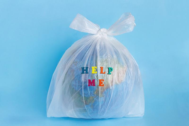 Help me and Model planet Earth in polyethylene plastic package stock photos