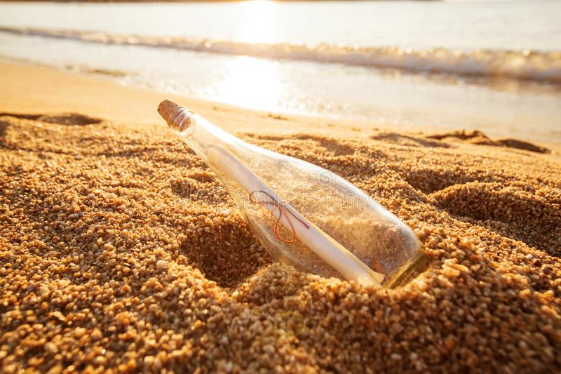 Help message bottle beach royalty free stock photos