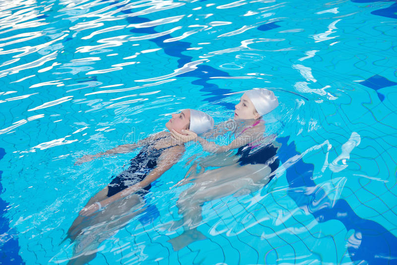 Swimming Pool Action : Help and rescue on swimming pool stock photo image of