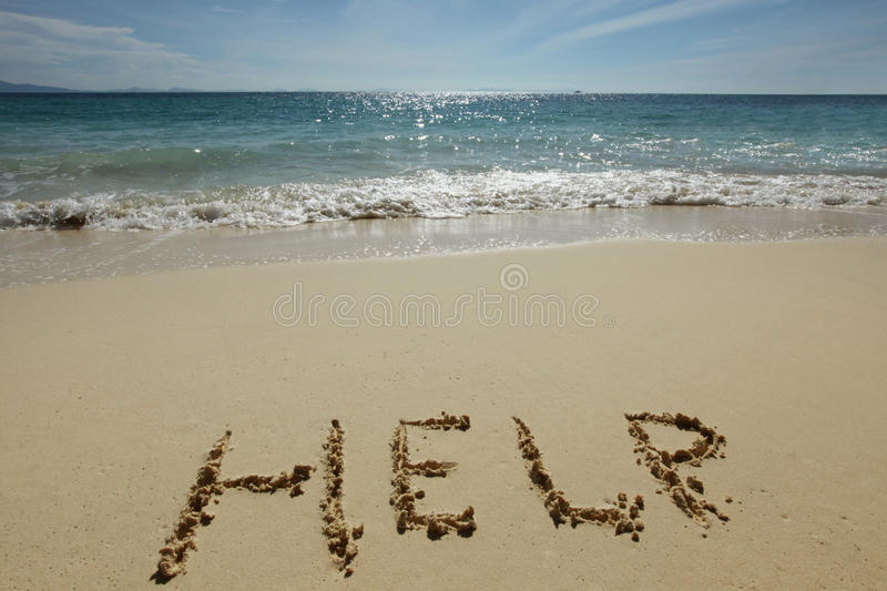 Help Sign on the beach. Help Sign on the sand of tropical sea beach royalty free stock images