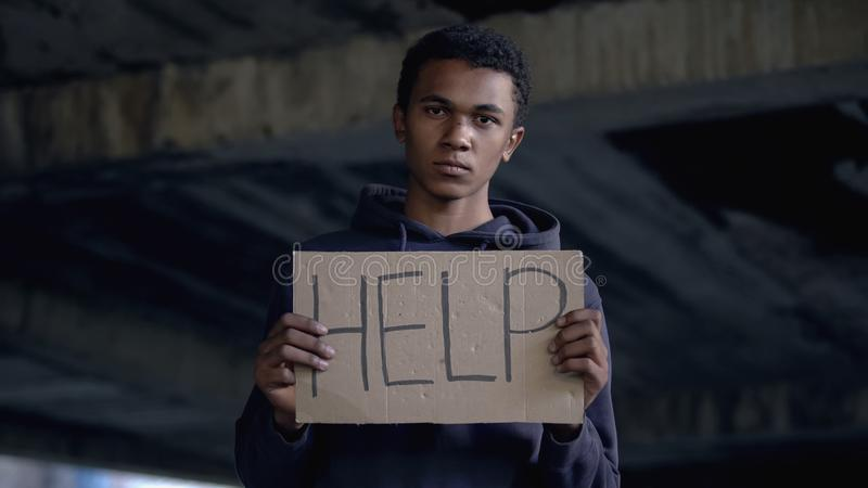 Help sign in black teenager hands, sad violence victim, human rights, bullying royalty free stock photos