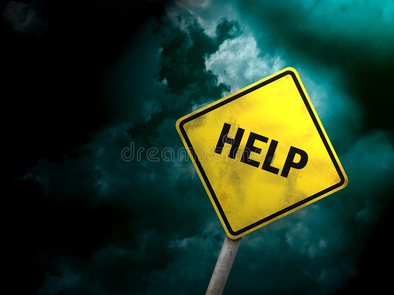 Help sign. Under a dark sky we see signal request for help stock image