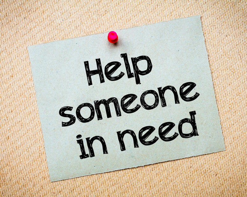 Help someone in need. Message. Recycled paper note pinned on cork board. Concept Image royalty free stock images