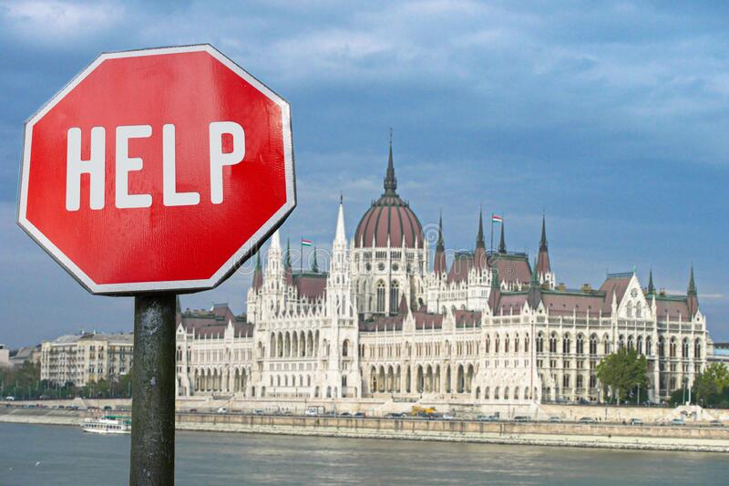 Help stop sign with view of parliament in Budapest, Hungary. Humanitarian and economic help during economic crisis and coronavirus pandemic. Help for local stock images