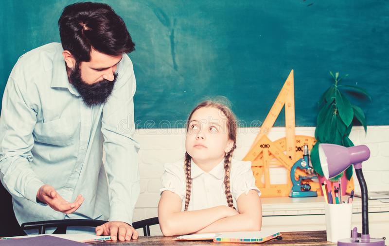 Help and support. education child development. daughter study with father. Teachers day. bearded man teacher with small stock images