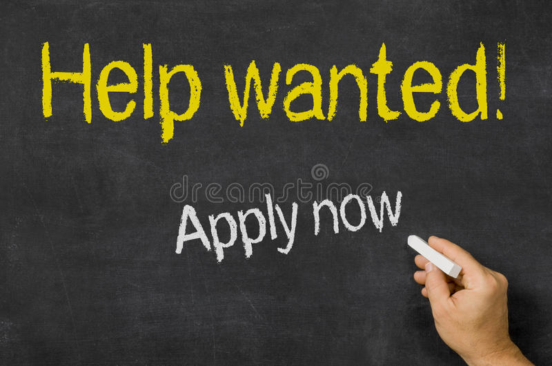 Help wanted. Blackboard with the text Help wanted royalty free stock image