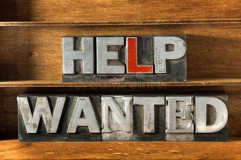 Help wanted tray. Help wanted phrase made from metallic letterpress type on wooden tray stock images