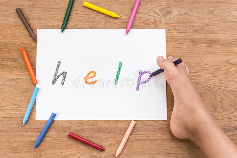 HELP in white paper writing by right foot of disabled people o royalty free stock photo