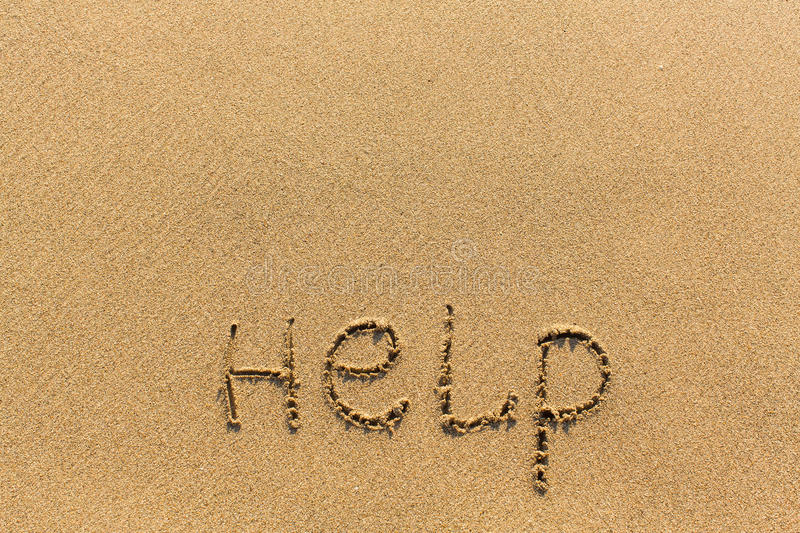 Help - word drawn on the sand beach. Abstract. Help - word drawn on the sand beach royalty free stock photo