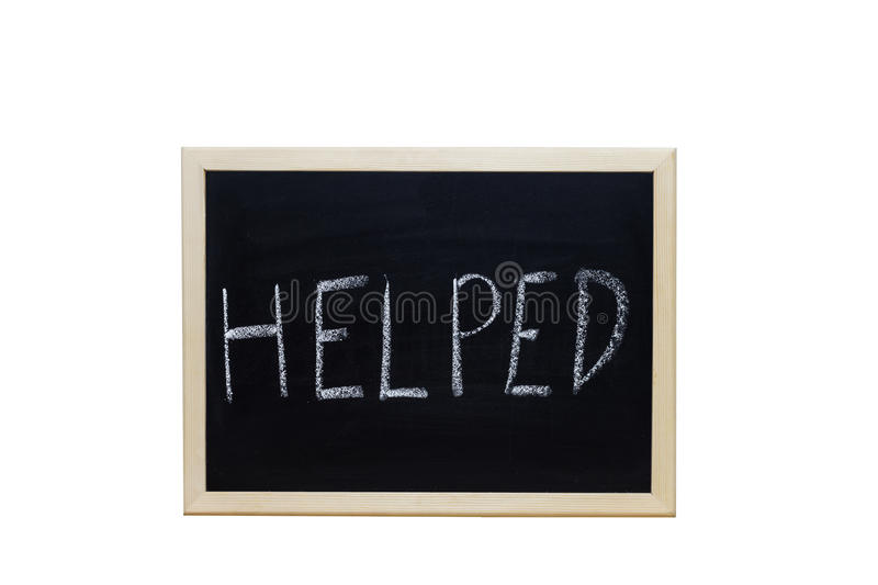 HELPED written with white chalk on blackboard royalty free stock images