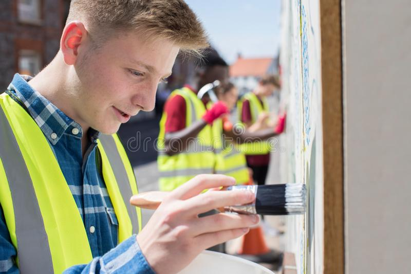 Group Of Helpful Teenagers Creating And Maintaining Community Ar. Helpful Teenagers Creating And Maintaining Community Art Project stock image