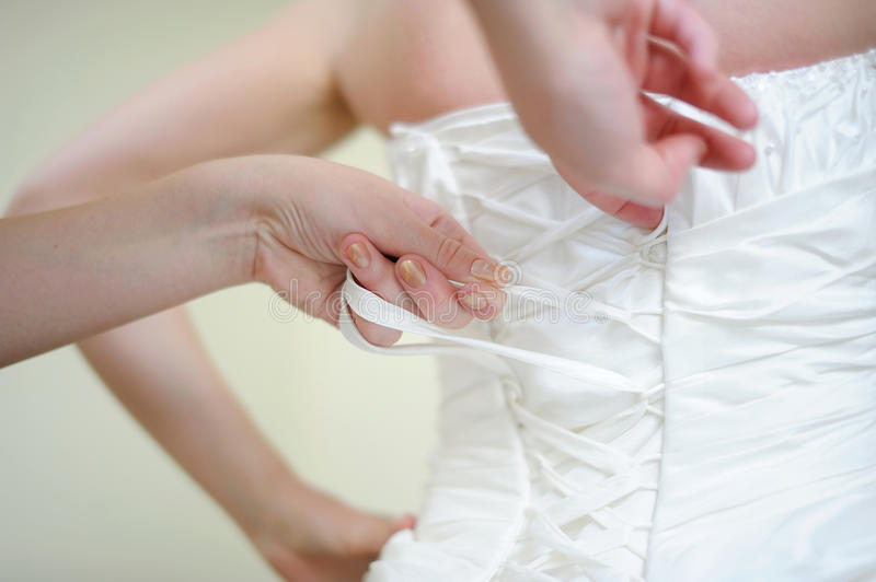 Download Helping The Bride To Put Her Wedding Dress Stock Image - Image: 21630947