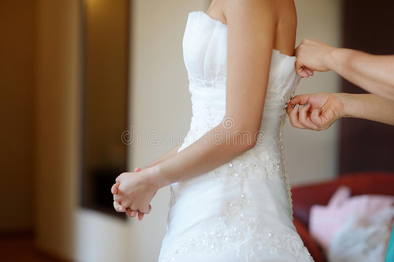 Helping The Bride To Put Her Wedding Dress Royalty Free Stock Photos
