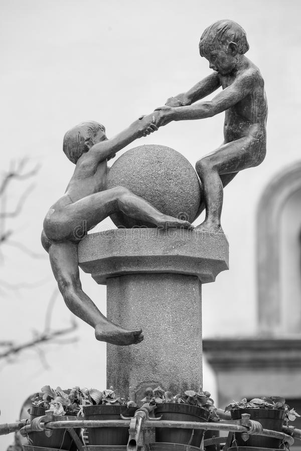 Helping. Children who help each other statue royalty free stock photography