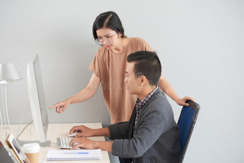 Helping coworker stock photos