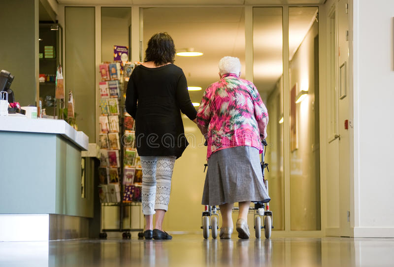 Helping elderly woman royalty free stock images