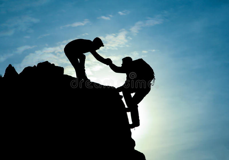 Helping hand for a climber royalty free stock photography