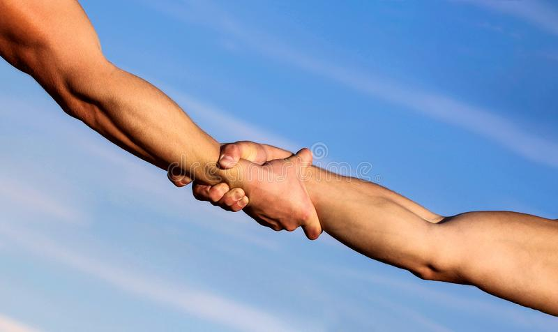 Helping hand concept and international day of peace, support. Two hands, helping arm of a friend, teamwork. Hands of on royalty free stock image