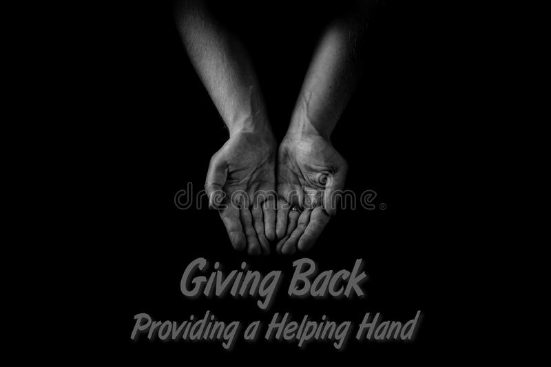 Helping hand concept, Man`s hands palms up, giving care and support, reaching out, Giving back to community stock image