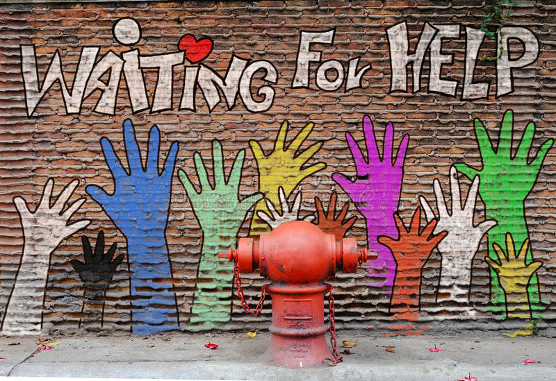 Helping hand painting. Helping hand paint on the wall stock image