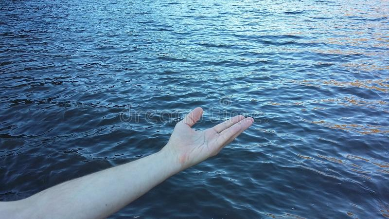 Helping hand on the sea royalty free stock photos