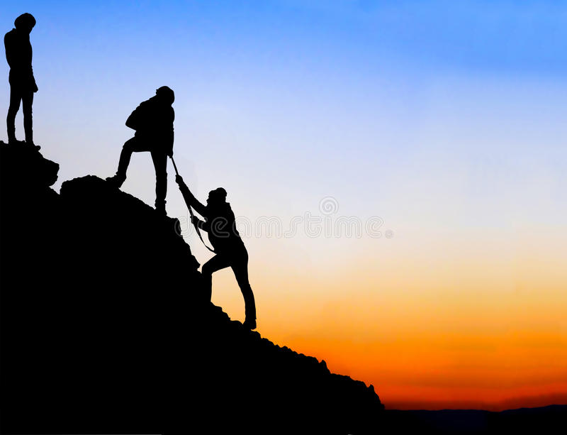 Helping hand between three climber royalty free stock image